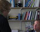 A frustrated grandmother talks to a principal in the principal's office