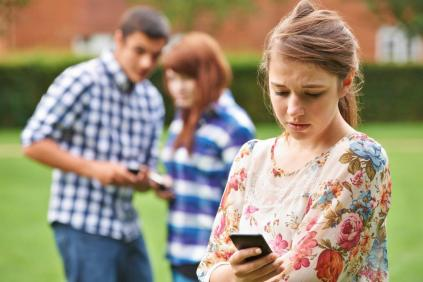 students looking at mobile phone